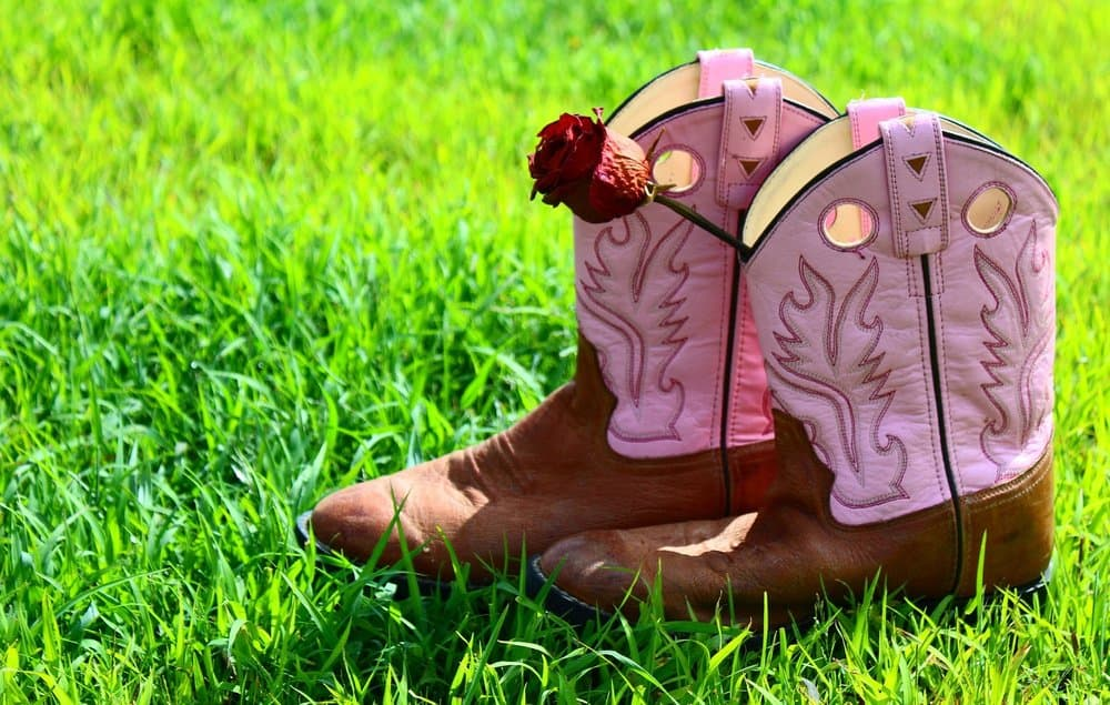 pink cowboy boots on the grass
