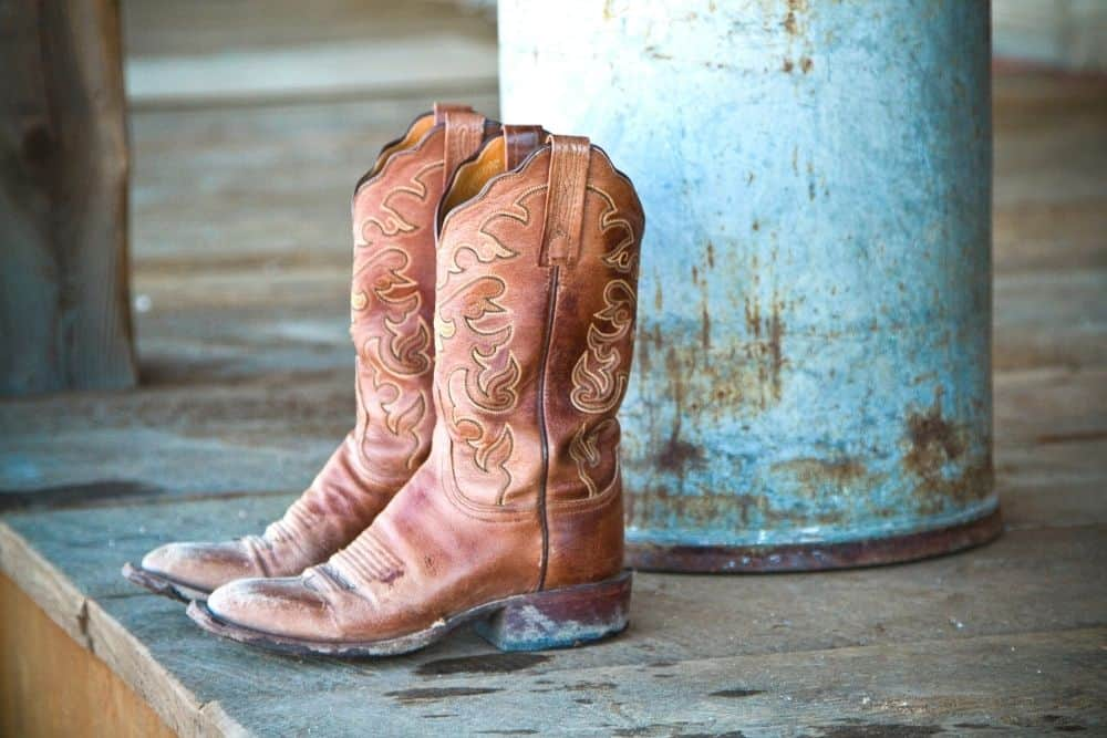 How to Clean Muddy Cowboy Boots? - Cowboy boots are born to serve the needs of cowboys and farmers on the farm. They need sturdy, affordable boots that give their feet the best protection. To this day, keeping the tradition like that, outside of the wonderful beauty that God gives, cowboy boots still wander and walk in the fields a lot. Because of working on the muddy and sunny farms in the West, cowboy boots need to be cleaned regularly to keep the outside fresh and lasting for years. And mud is one of the most annoying foes for your cowboy boots, which is very common during the rainy season. Today we will learn about how to clean muddy cowboy boots. This is a huge headache for cowboys! Let's check it out!