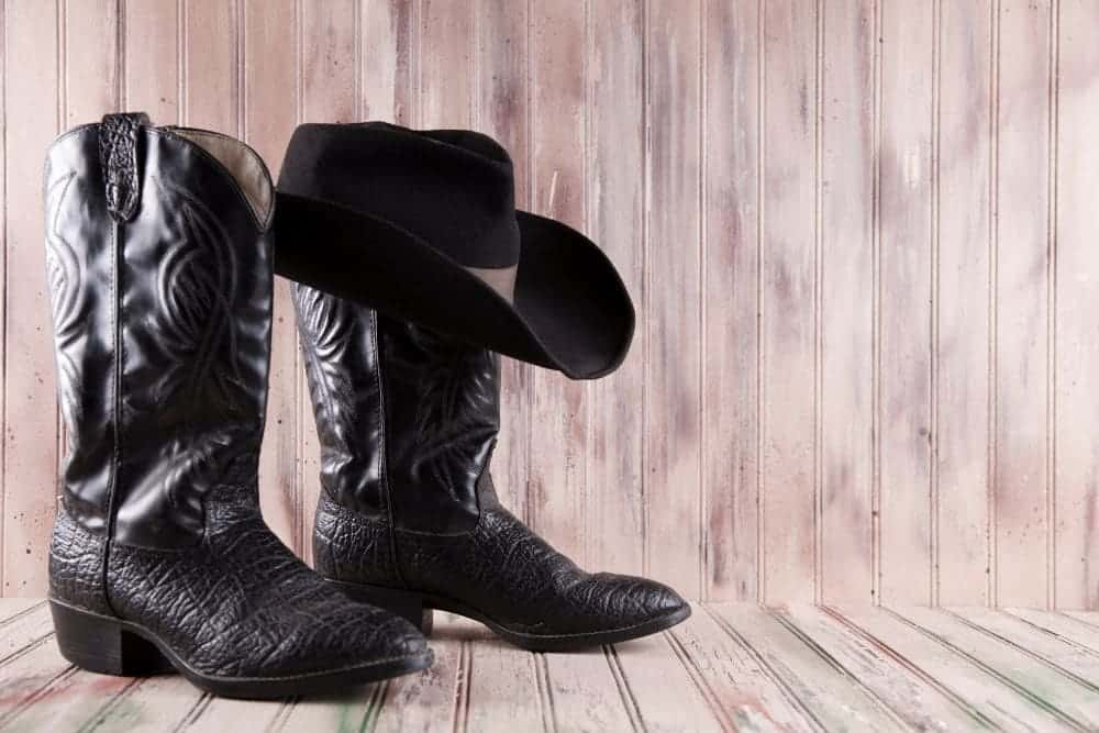 black cowboy boots and hat