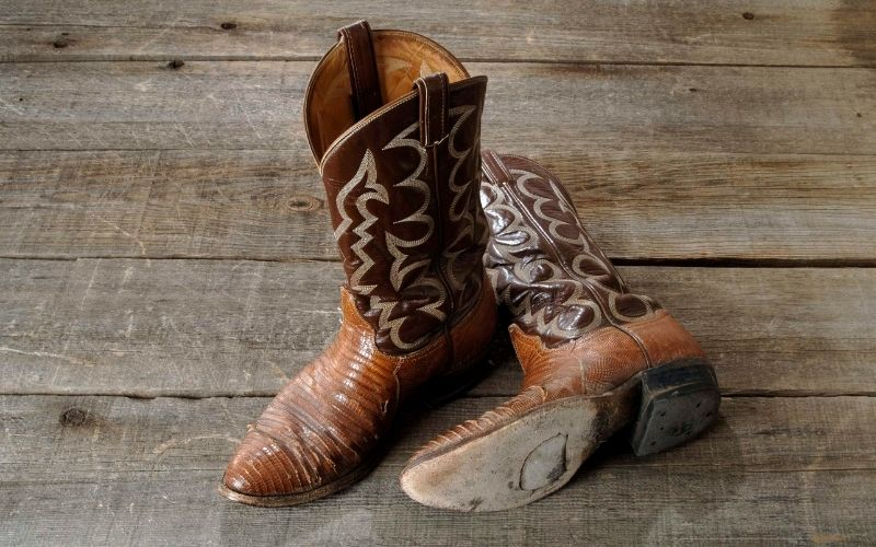 a pair of cowboy boots on the wood floor