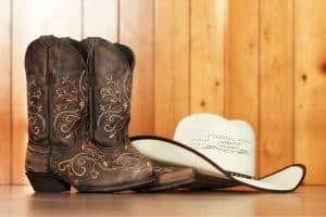 Types of cowboy boots for line dancing There are many different types of cowboy boots, such as Roper boots, Buckaroo boots, Riding boots, Western work boots, Stockman, Western boots, etc. Roper boots and Riding boots are two favorite types of cowboy boots for line dancing. They have the classic western look that has been loved for centuries. Roper boots are well designed with low heels and a wide toe box, which helps you get comfort and balance while dancing. Unlike roper boots, riding boots usually have high heels and pointed toes. People often prefer to use riding boots because of the gorgeous sound that their heels give. You can also use western work boots, as these boots are extremely comfortable. The downside is that their grip is too good, you might find it difficult to make line dancing moves.