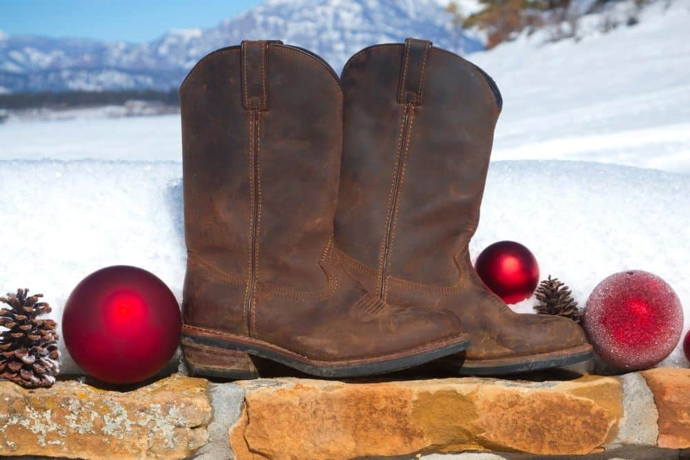 cowboy boots in snow and Christmas