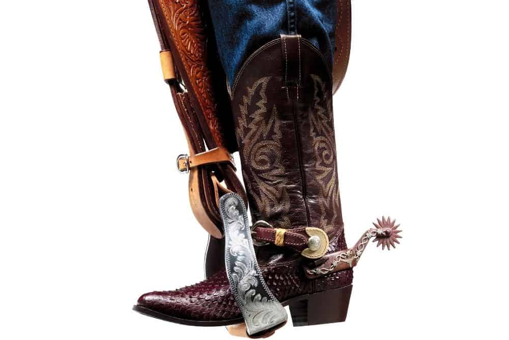 jeans, cowboy boots and saddle's stirrup
