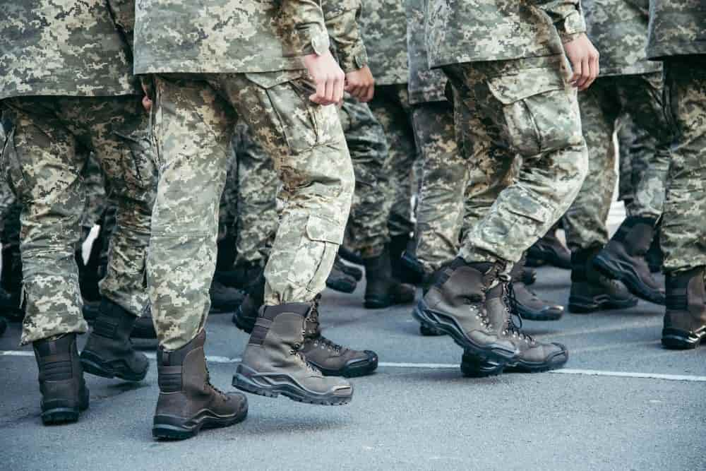 many soldiers wearing Merrell tactical boots