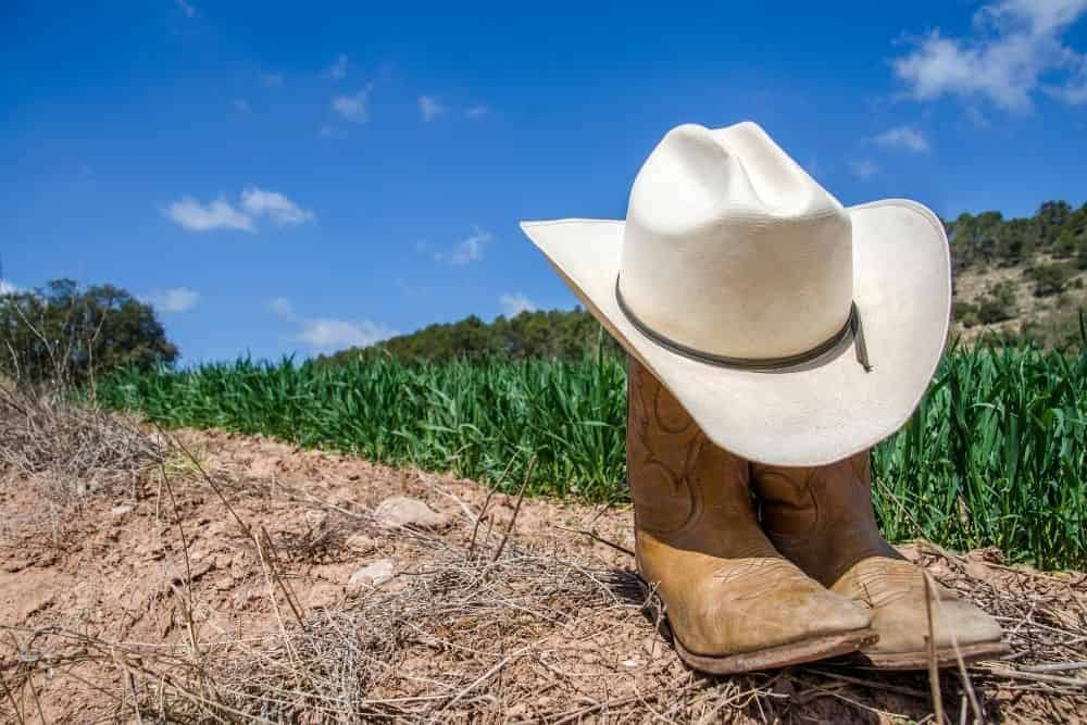 tan cowboy boots with hat for hiking