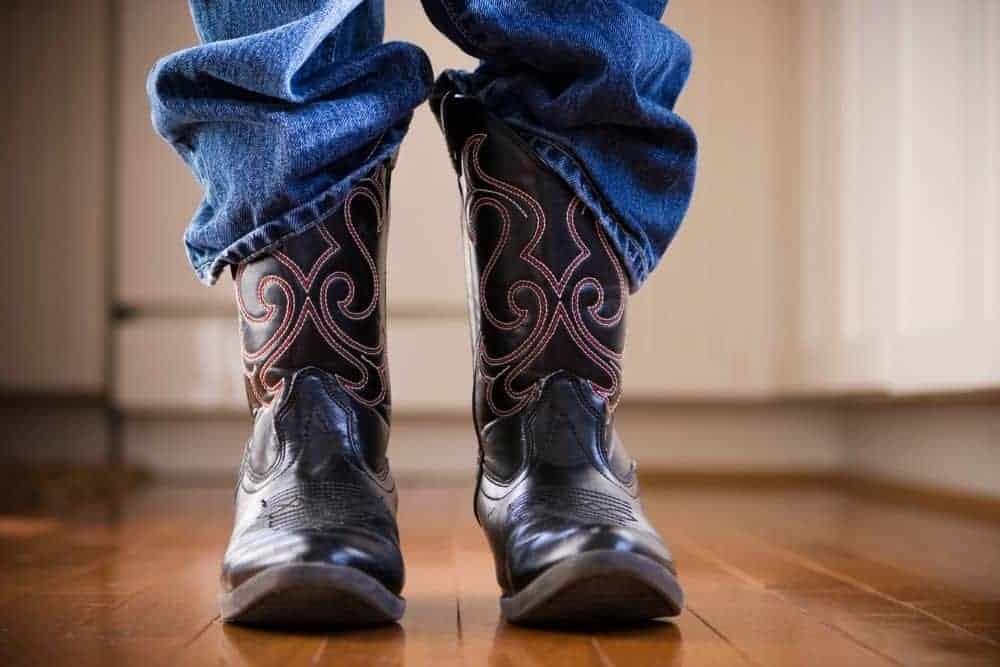 jeans and glossy cowboy boots with no creases