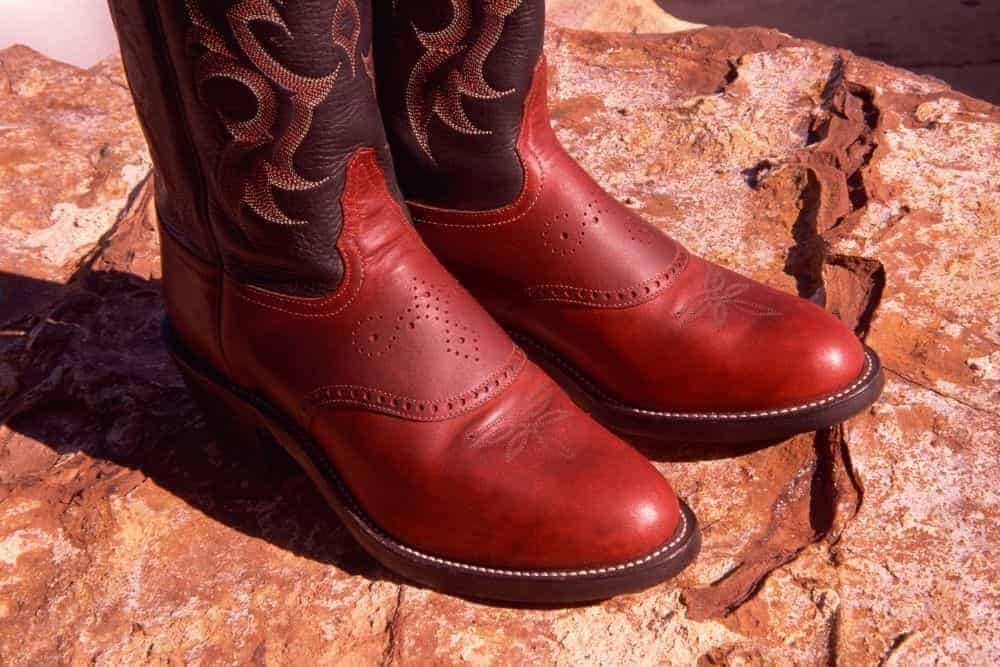 Burgundy cowboy boots for business casual look