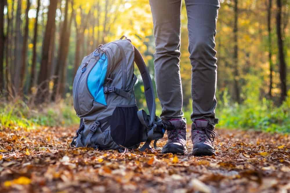 backpack and non slip hiking boots for journey in forest