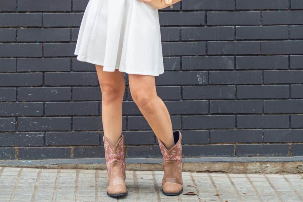 wear white dress and cowboy boots for skinny legs