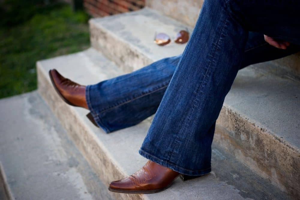 cowboy boots and jeans for fashion purpose