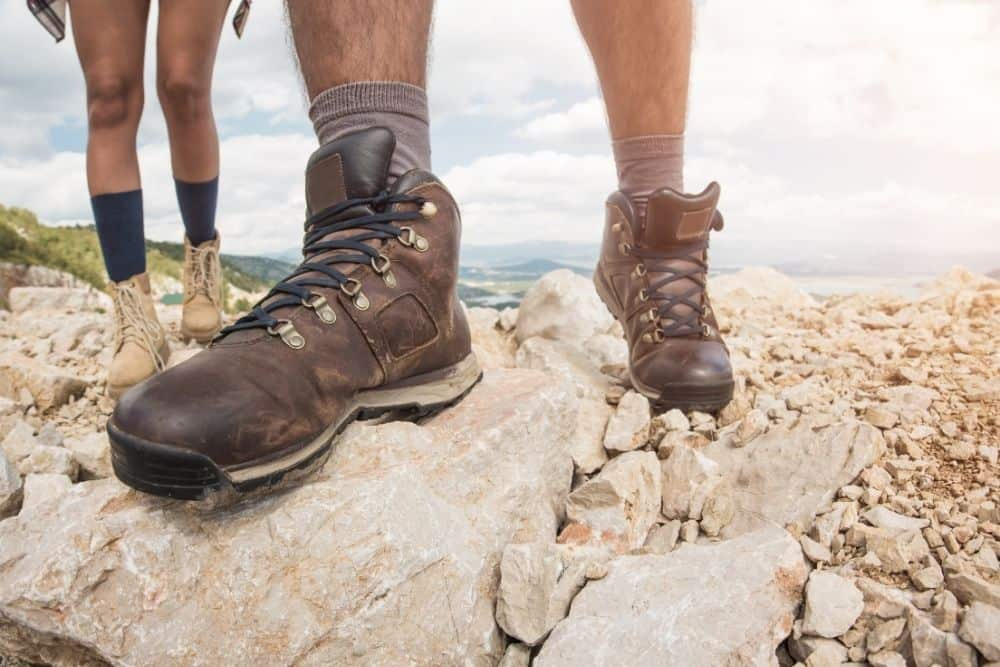 durable stiff hiking boots on rocky surface