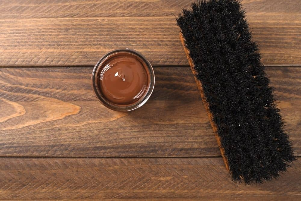 horsehair brush and brown dye for hiking boots