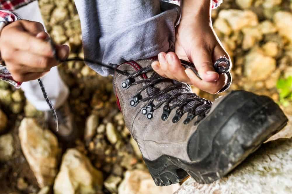 man wearing lightweight hiking boots for his trip