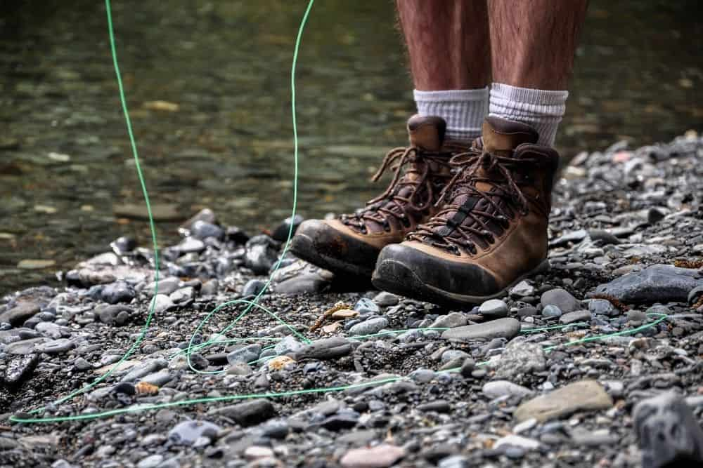 man wearing white socks and lightweight hiking boots