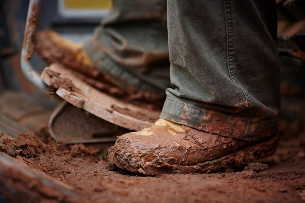 men wear muddy boots for driving