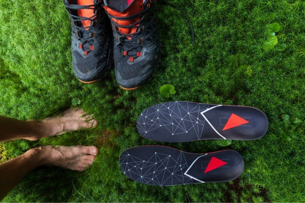 people feet, insoles and hiking boots