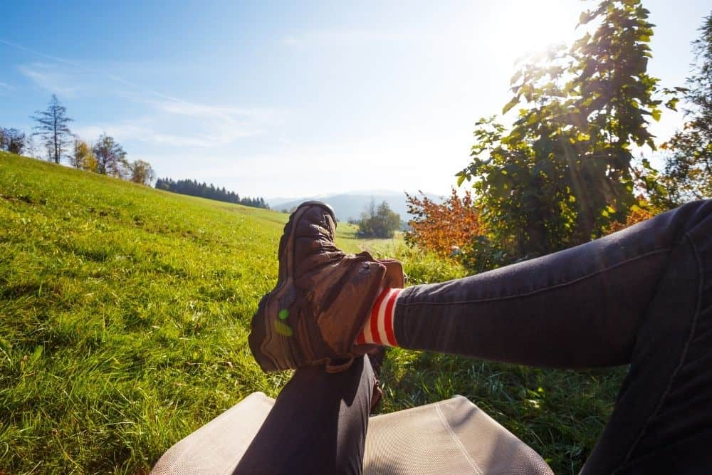 red and white striped socks with hiking boots in summer