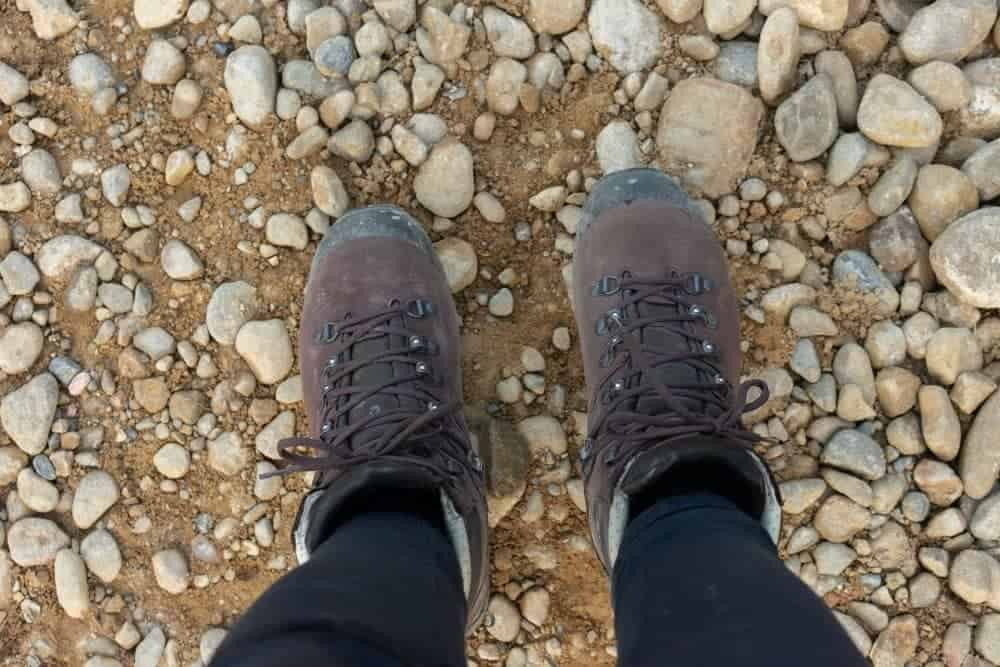 running with hiking boots on pebble strewn path