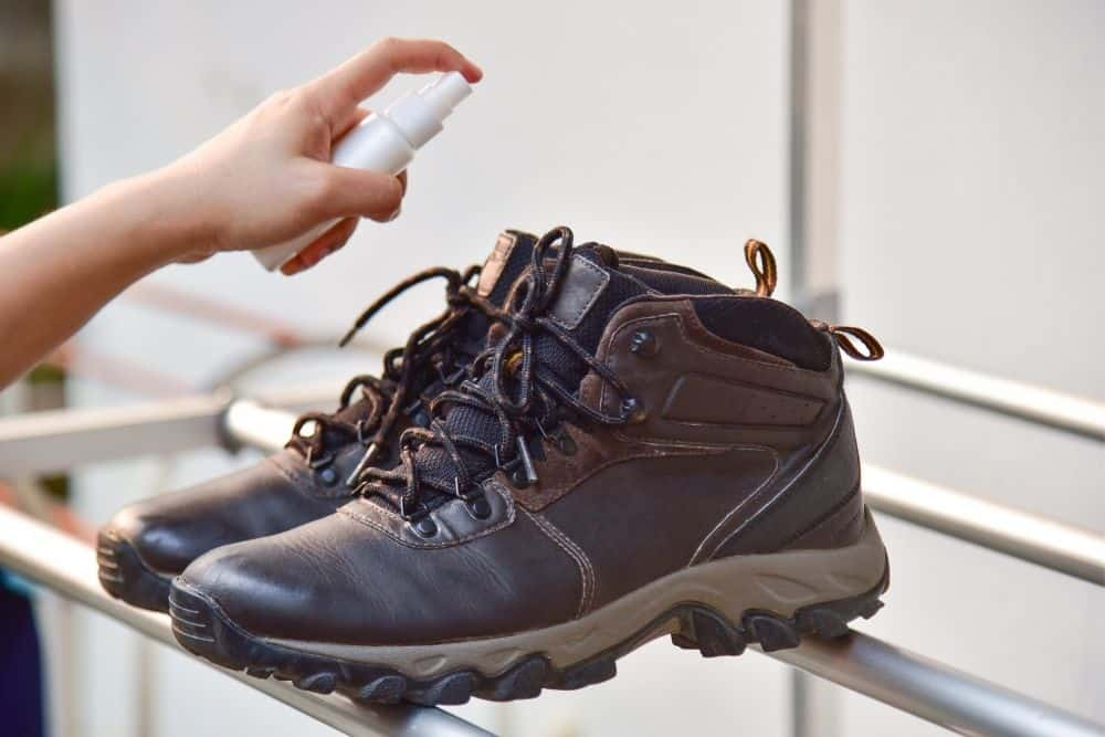 spray alcohol on hiking boots to soften them
