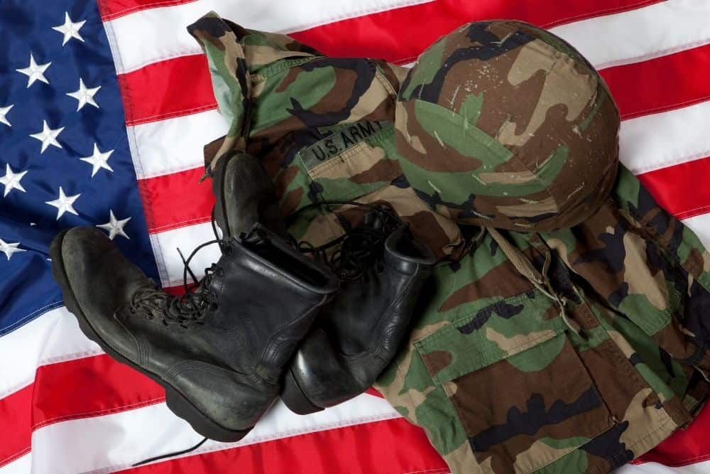 tactical boots and outfit on an American flag