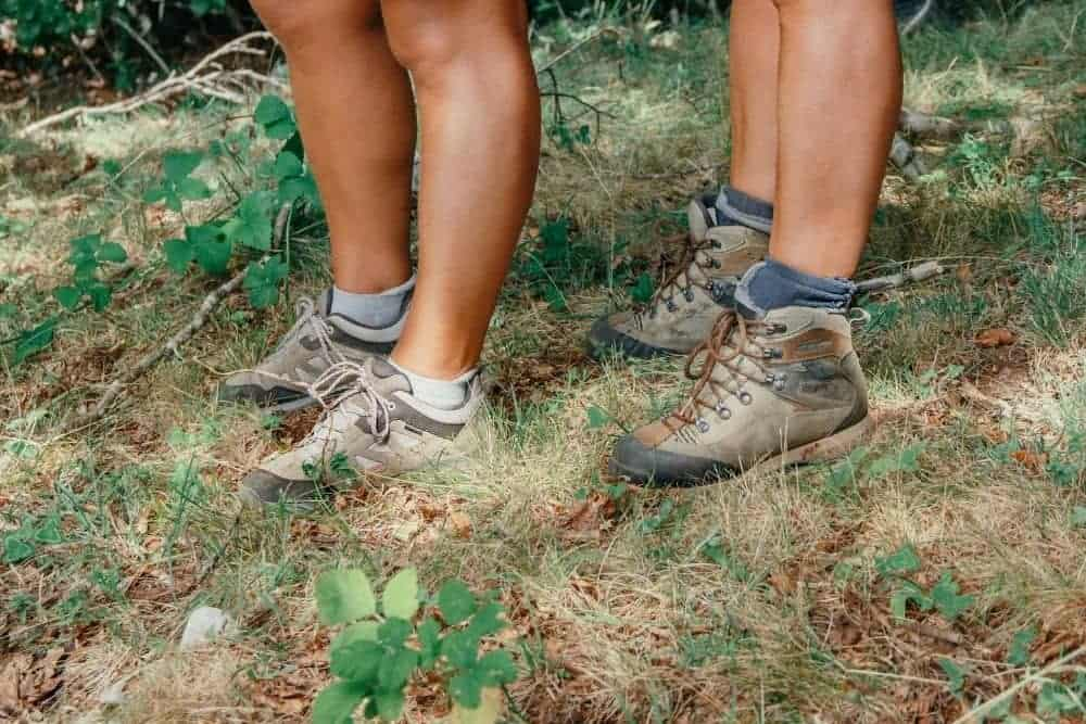 two men wear stiff hiking boots with ankle support