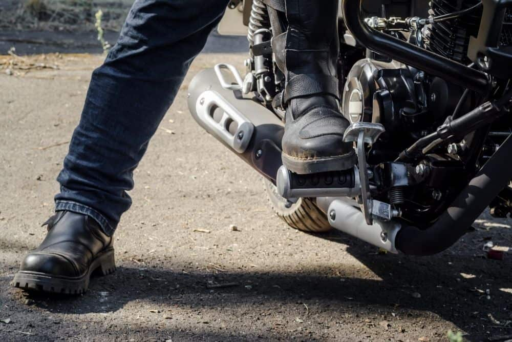 two people wearing motorcycle boots