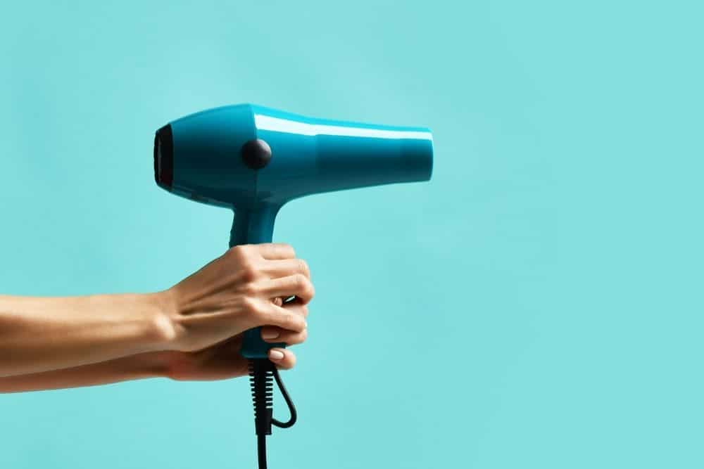 use hair dryer to stretch hiking boots