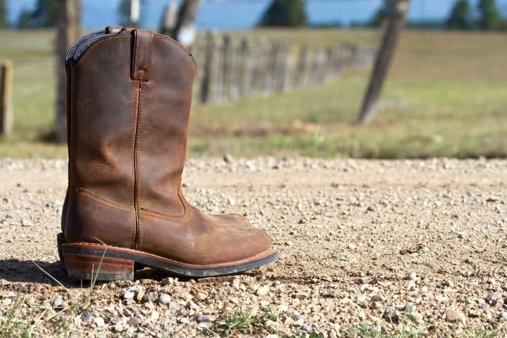 a pair of western boots on the gravel road