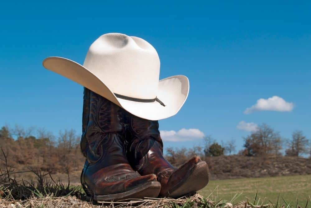 distressed cowboy boots on the road
