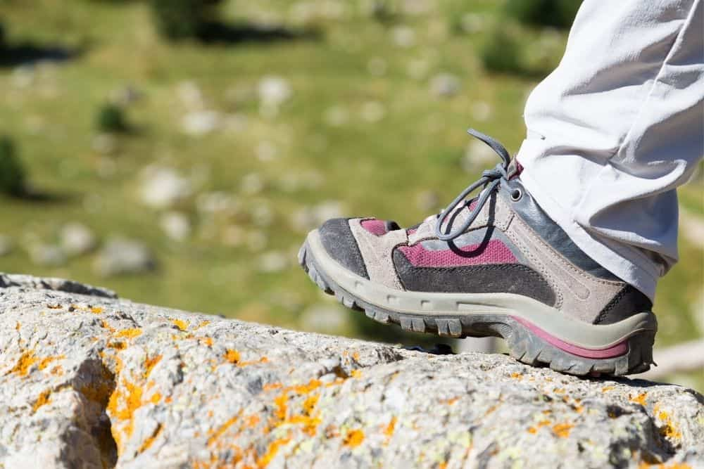 hiking boots with heels on a rock
