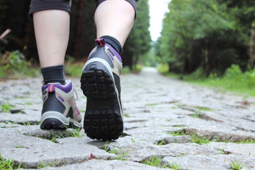 hiking boots with heels on stone paved path