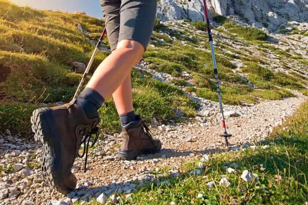hiking boots with heels on stony road